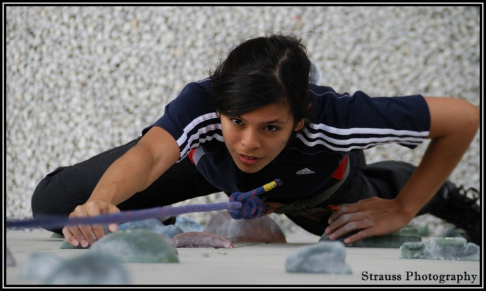 3888348117_b30152e4a4_b woman climbing wall via flickr strauss photography